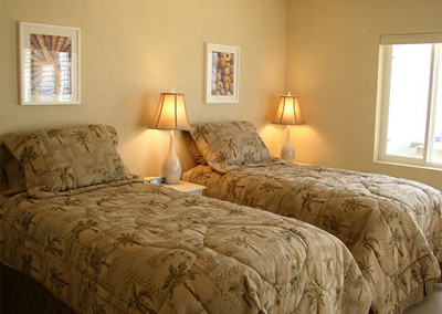 The guest bedroom has two twin beds which can be combined to form a king size bed.