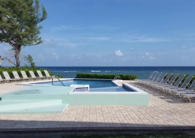 Enjoy a lovely Cayman breeze while sitting poolside.